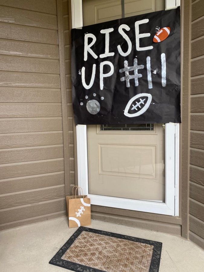 Posters+were+painted+and+hung+on+each+player%27s+front+door.+The+team+wanted+to+surprise+the+seniors+with+an+assortment+of+items+and+snacks+as+well.+%E2%80%9CWe+painted+the+football+stripe+and+design+on+the+brown+paper+bags%E2%80%9D%2C+senior+Phoebe+Rackliffe+said.+It%E2%80%99s+always+a+fun+time+with+the+team+when+we+make+different+things+like+this.%22%0A