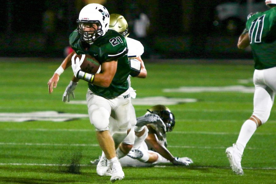 "Junior Nathan Pederson avoids defenders to get his second rushing touchdown of the night. He would end up having 136 yards on the ground and three touchdowns. ""I'm excited to see what our team can do,"" sophomore tight end Brandt Pickrell said. ""I know Thursday wasn't the outcome we wanted, but we have a very talented team and I'm excited to see what we will do the rest of the season."""