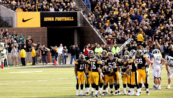 In this picture you see the fans cheering on the Hawks against Michigan State. While there are no fans in attendance Iowa will still try to keep on traditions such as waving to the Children's hospital at the end of the first quarter.