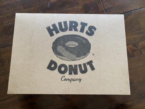 A box of Hurts donuts. You can get either get a single donut, six donuts or a dozen.