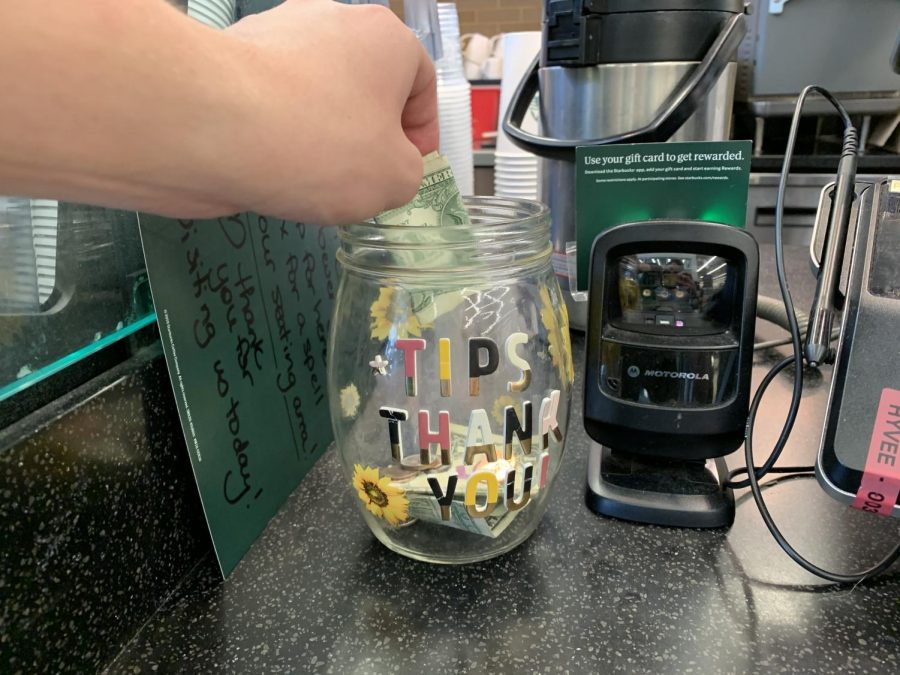 Starbucks workers receive tips from their customers throughout their workday.  A customer's generosity benefits the workers by providing them more wage and appreciation for their hard work.