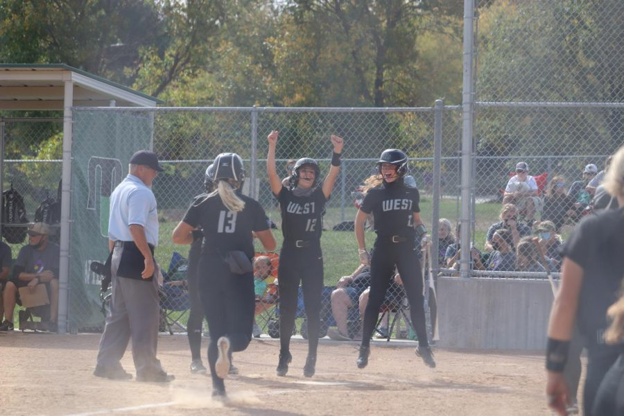"Millard West players celebrating after a home run hit by junior Bella Bacon. She had over five home runs this year. ""I feel like we did a good job of staying positive and together even through our schedule was very tough,"" senior Hannah Roberts said. ""We could have done better, but we had good chemistry and effort all season."""