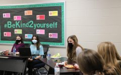 Diversity Council members eat lunch and discuss at an October meeting. They focused on the topic of racial identity.