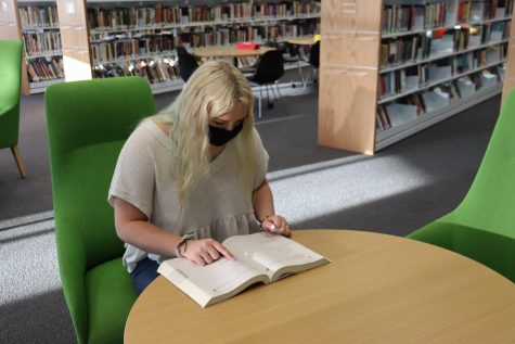"Junior Annabelle Harshbarger studies in the library. This was days after taking the pre-ACT. ""I use the ACT test prep books because they"