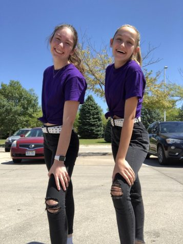 "Above is a picture of Bersch and Hennessy in their favorite outfit of the year. They are wearing Black ripped jeans, a white belt and a purple tee shirt. ""Purple is both of our favorite colors,"" Bersch said. ""And we think the outfit is overall very cute and matches our style really well."""