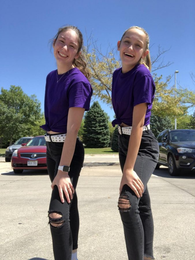 """Above is a picture of Bersch and Hennessy in their favorite outfit of the year. They are wearing Black ripped jeans, a white belt and a purple tee shirt. """"Purple is both of our favorite colors,"""" Bersch said. """"And we think the outfit is overall very cute and matches our style really well."""""""
