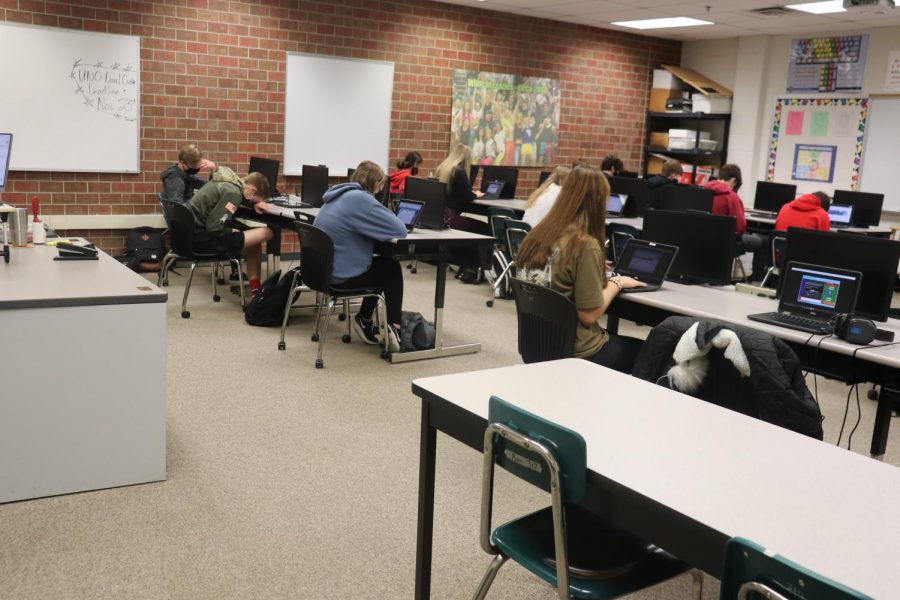 """Students work on their computers in German. All of them are invested in learning what their teacher is teaching them. """"I work better in an environment with people,"""" sophomore Mackenzie Cory said. """"It is harder to learn when I am at home. I do hope we go back to school the Monday after break."""""""