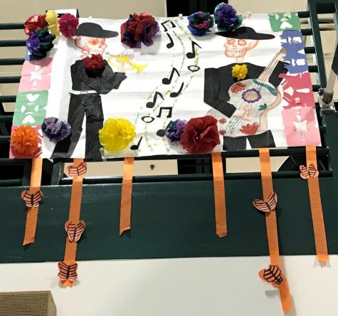 """Juniors Garrett Wilcoxen and Braedyn Thompson and seniors Emma Cavalier and Danny Baron worked for a week to create their winning barrilete. Their class periods were filled with drawing, cutting and painting. """"To construct our barrilete, we first had to start with the most fitting theme,"""" Cavalier said. """"We agreed upon a skeleton mariachi themed barrilete because it has many components that represent El Día de los Muertos."""""""