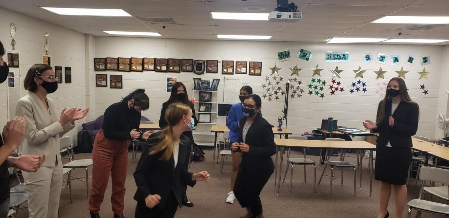 """The Millard West Forensics team gets hyped up for their first meet of the 2020-21 competition season. Although the team did not get to attend the meets in person they still worked hard to prepare for their first virtual meet. """"Preparing for the first competition of the season was definitely different than any other year,"""" Cavalier said. """"Instead of practicing looking at an audience I had to get used to looking at one focal point."""""""