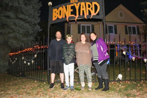 Located just across from Millard West on the corner of Renfro Street and 176th Avenue, the cemetery draws in families from all across the neighborhood who come to watch in awe as Smith's house is illuminated with multi-colored lights and dancing skeletons.