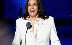 "Vice President-elect Kamala Harris wears suffragette white onstage to give her victory speech, a nod to the official colors of the National Woman's Party. During her speech, Harris paid homage to the women who came before her: ""Tonight, I reflect on their struggle, their determination, and the strength of their vision—to see what can be unburdened by what has been—I stand on their shoulders."""
