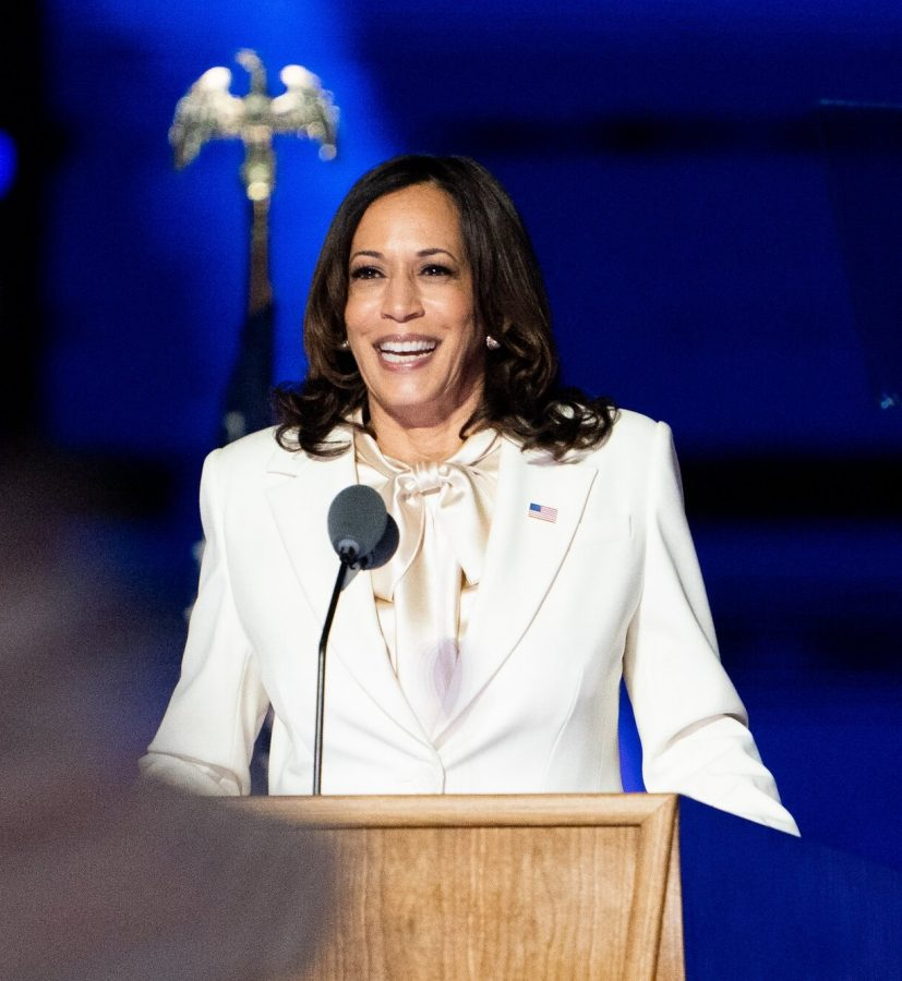"""Vice President-elect Kamala Harris wears suffragette white onstage to give her victory speech, a nod to the official colors of the National Woman's Party. During her speech, Harris paid homage to the women who came before her: """"Tonight, I reflect on their struggle, their determination, and the strength of their vision—to see what can be unburdened by what has been—I stand on their shoulders."""""""