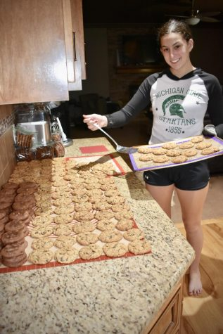 """Junior NHS member Macy Klein dedicates her time to the Treats for Troops service project. """"I wanted to get involved in making cookies for troops because I love baking,"""" Klein said. """"It is especially meaningful for me to help out those who are fighting for our country!"""""""