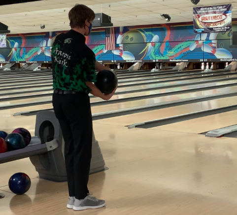 """Kirk gets set for his next turn to bowl. He competed in game one and scored a 149, as well as helping the team to a combined score of 172 in the Baker game. In the Baker game the team was able to work well together giving them the final points they needed to secure the victory. """"Our teams work really well together,"""" Smith said. """"They cheer each other on when they're bowling well, and they encourage each other if someone is struggling. Their attitudes are a big factor of their success."""""""