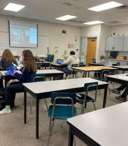Some students sit, socially distanced, in a public school classroom while others appear on Zoom. As Secretary of Education Betsy DeVos refuses to attend discussions about school reopenings, students and teachers are adapting and showing resilience.