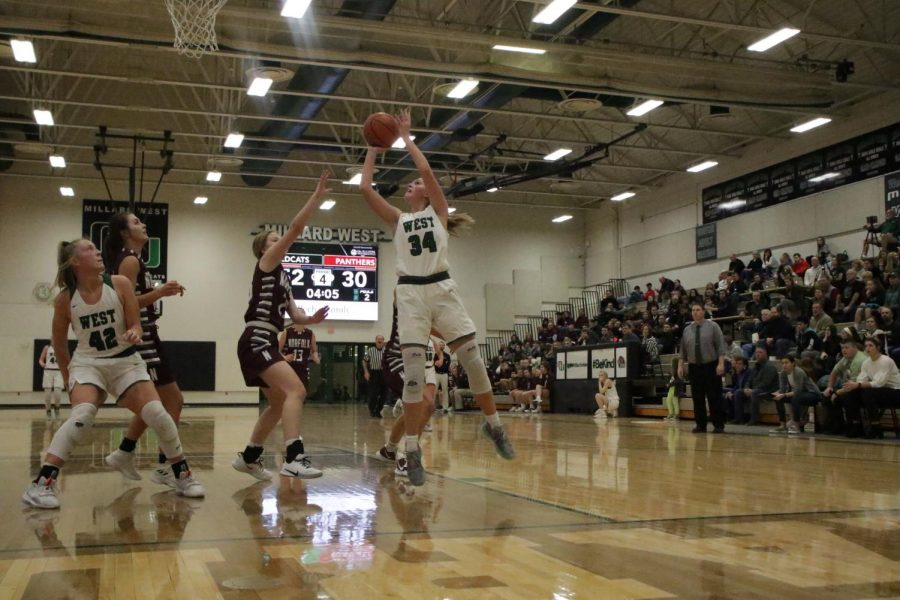 "Senior Laney Schipper fighting for the ball in a game against Omaha Bryan. This is Schipper's third year on varsity and she is the most experienced player on the team.""Laney knows what it takes to compete at this level,"" head coach Marc Kruger said. ""We are looking for her to be a consistent scorer and defender."""
