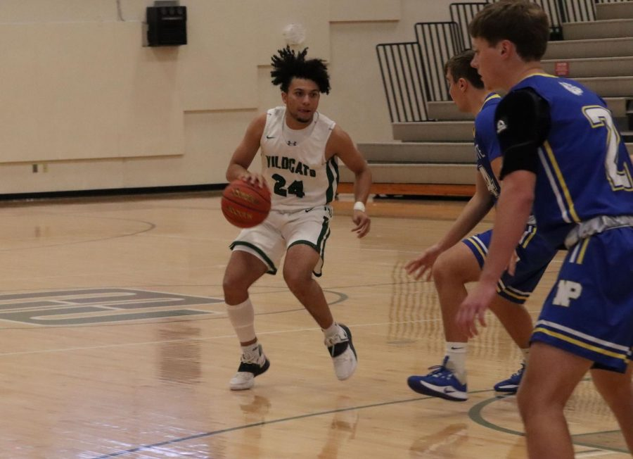Senior Wildcat guard Dominic Humm sets up for an offensive play against the North Platte Bulldogs. Humm finished the weekend with 43 points, averaging 21.5 through the first two games. Humm looks like one of the more potent offensive threats in the metro.