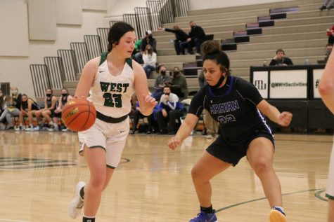 "Senior Reese Peterson of Millard West being guarded by senior Aryannah Harrison of Marian. The game was a very defensive match with a lot of fouls and turnovers. ""We knew going into the game that Marian had two really good players who have found many different ways to score so we had to keep them under control,"" Peterson said. ""Our game plan was to kind of make the rest of the team beat us."""