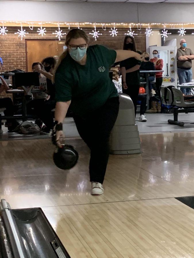 """Senior Kaitlyn Dickmeyer rolls the ball down the lane. She thinks that she needs to improve on some of her skills. """"The skill that I would like to improve for the next meet is to keep my elbow in,"""" senior Kaitlyn Dickmeyer said. """"I need to make sure that I don't top the ball which is when you twist your wrist too much which will cause it to go more towards the left."""""""