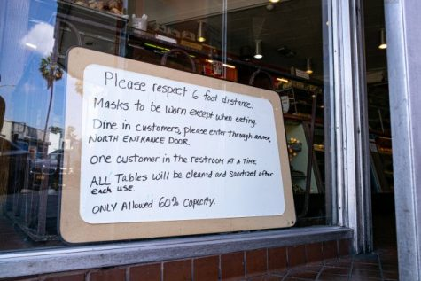 Owners put our signs on their restaurants for incoming customers to follow in order to be safe. (Photo by David Crane)
