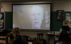"""Mike Spinharney, a Vietnam War veteran, visits Honors English 10 students, via zoom, to share his experiences during his time serving. """"My favorite story he told was when he said there were hippy-like people not letting him through the gate when he returned home from Vietnam,"""" sophomore Kyle Lorimer said. """"So he swung his duffle-bag around like a baseball bat and knocked them over."""""""