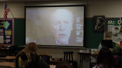 "Mike Spinharney, a Vietnam War veteran, visits Honors English 10 students, via zoom, to share his experiences during his time serving. ""My favorite story he told was when he said there were hippy-like people not letting him through the gate when he returned home from Vietnam,"" sophomore Kyle Lorimer said. ""So he swung his duffle-bag around like a baseball bat and knocked them over."""