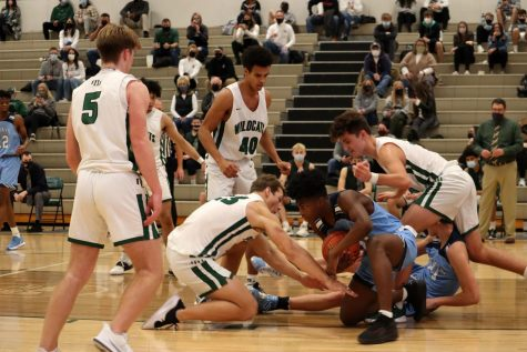 Multiple Millard West players scrambled for a loose ball in their 42-40 loss against Creighton Prep. The play summed up the game, as it was a slugfest from the start. The Junior Jays only shot 34% from the floor, while the Wildcats only took half as many shots as Prep.