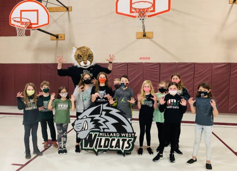 Rohwer PE students stand together showing off their Wildcat apparel.
