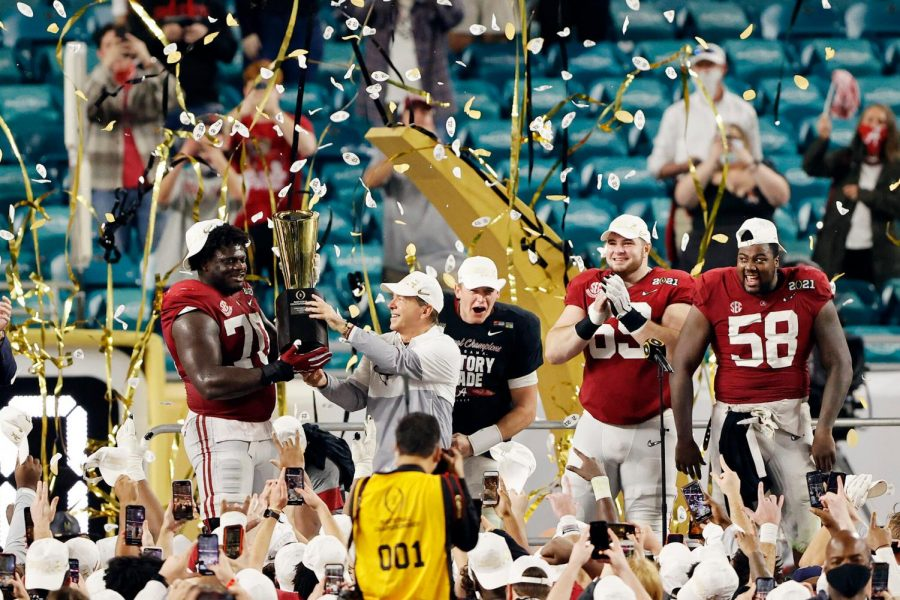 "Alabama is pictured celebrating after a perfect season capped off with a National Championship victory. ""I'm so happy for the team,"" Saban said. ""Their will, their spirit and their willingness to compete and do the things they needed to do to be the kind of team they could be."""