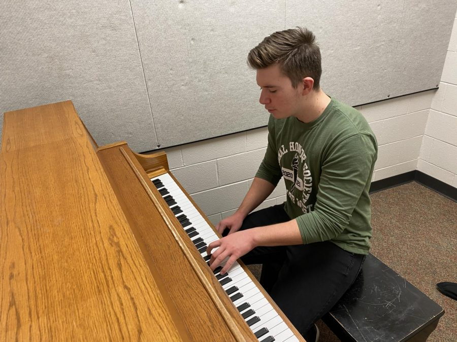 "Senior Dominic Zohlen practices the piano. He taught himself to play by ear and also sings along with it. ""Several months ago, I decided I wanted to pursue music even further by writing, producing, and uploading my own music for everyone to enjoy,"" Zohlen said. ""I use a Digital Audio Workstation called Reaper to record and produce my music."""