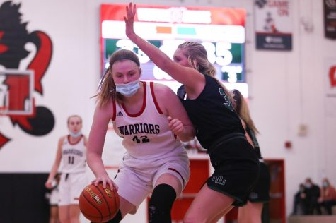"Sophomore Lucy Schonlau being guarded by senior Laney Schipper in the Westside vs Millard West game. Schipper and Schonlau combined for 31 points in this game. ""We all just played the best we could and never gave up till the end,"" sophomore Effie Golliday. ""I just hope we can take that momentum to the rest of our season."""