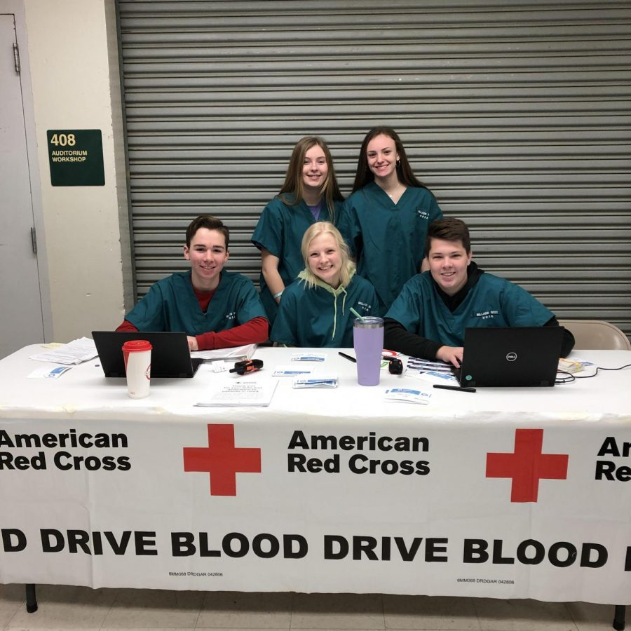 "HOSA members volunteering for past blood drives, helping donors sign in and get registered. ""We have not had our HOSA students volunteering at the drives this year,"" HOSA sponsor Jeanne Meyer said.  ""All blood drives have been off-site so our West students did not 'work' the blood drives like they have in years past, however, they still volunteer their time in recruiting donors."""