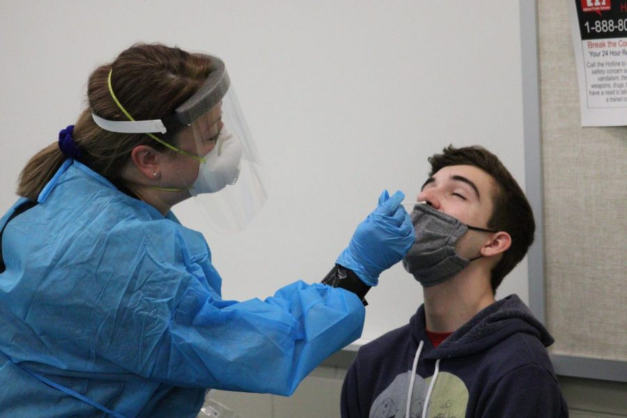 Senior Owen Hamill receives his COVID-19 test in the lecture hall on Friday, January 29. Medical professionals from Test Nebraska set up shop in the lecture hall and administered tests to students and staff.