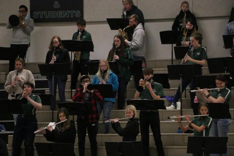"Pep band performing in the bleachers for a basketball game. Many of these students being seniors, they are enjoying their last year playing for the school.  ""Even when we weren"