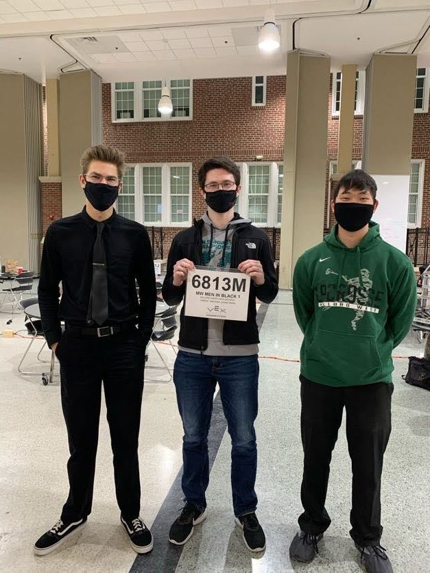 """Posing with their team name, seniors Michael Nigrila, Mark Schaffer, and college freshman Luke Hartman participate at the VEX """"Change Up"""" Robotics Championship at Thomas Jefferson High School in Council Bluffs. Their competition was for the most part a victory for the Millard Wests robotic teams. """"It was a very enjoyable experience interacting and partaking in this event,"""" senior Michael Nigrila said, """"We also got the opportunity to socialize with teams from other schools and we had some downtime with a former team member (Luke Hartman) at the end of the competition."""""""