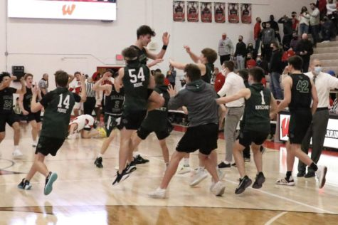 """Millard West celebrates after their 55-54 win over Westside. They play Lincoln Pius X in the state tournament on March 9. """"It felt like I was on cloud nine for the night,"""" junior Chase Hultman said. """"Celebrating with all of the guys and our friends in the student section was a lot of fun and knowing that we would get a chance to play in Lincoln is really cool, but we still have to approach it as any other game so that we can keep playing in Lincoln instead of being one and done."""""""