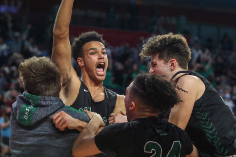 Senior Forward Evan Meyersick celebrates a quarterfinals win after his game-winning shot Tuesday night at Pinnacle Bank Arena in Lincoln, Nebraska. The Wildcats beat Lincoln Pius X 47-45.