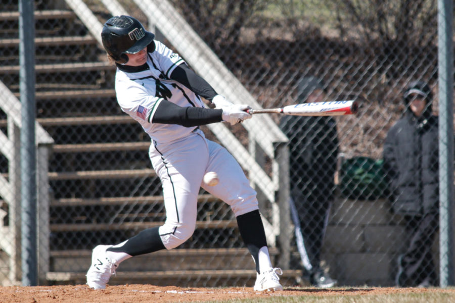 Senior+Tyler+Merkel+swinging+big+at+a+pitch+in+the+home+opener.+He+finished+the+day+with+a+total+of+six+RBIs+and+three+doubles.+%E2%80%9COur+momentum+from+winning+the+first+game+carried+over+into+the+second+one+and+I+think+that+just+overwhelmed+the+Northeast+guys%2C%E2%80%9D+Merkel+said.+%E2%80%9CWe+have+a+lot+of+trust+in+each+one+of+our+teammates+to+get+the+job+done.%E2%80%9D