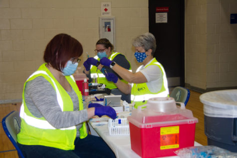 Nurses prepare to distribute vaccines at Millard North High School. In the last couple of weeks, thousands of school educators and staff have been vaccinated at weekend clinics.