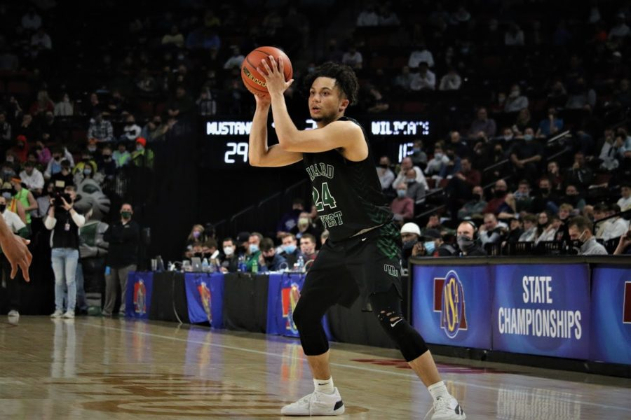 Senior+Dominic+Humm+looking+ahead+to+Millard+North+in+the+semifinal+round.+Humm+finished+with+12+points+on+50%25+shooting.+%E2%80%9CWe+knew+during+this+past+summer+that+we+could+be+a+team+that+could+make+a+run+at+State%2C%E2%80%9D+Humm+said.+%E2%80%9CThe+energy+was+different+from+the+year+before.+Everyone+on+this+team+is+a+hard+working+individual.+Throughout+the+year+we+were+just+focused+on+taking+one+game+at+a+time+to+get+our+goal+of+getting+to+State.%E2%80%9D