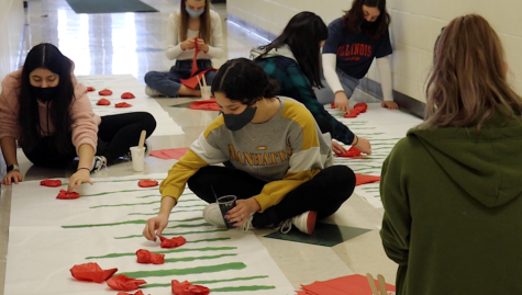 "Students continue a Millard West tradition of creating poppy fields in the English hallways during French week. Both members of French club and students enrolled in French class take control of planning and creating activities. ""I hope that people look forward to it every year,"" French teacher and club sponsor Sarah Karst said. ""We see it as an opportunity for the appreciation of the language and simply a celebration of the beauty of the language and the many cultures that accompany it."""