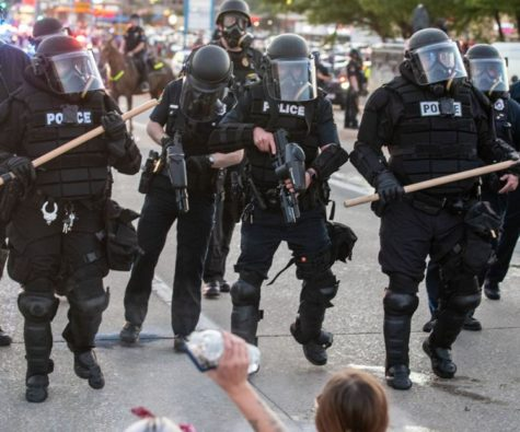 Omaha police fire pepper balls at protestors at a Black Lives Matter protest over the summer of 2020.