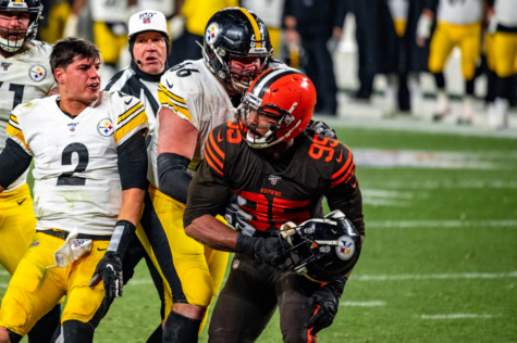 In what is now an infamous moment in NFL lore, Browns end Myles Garrett (95) took the helmet off of Steelers quarterback Mason Rudolph (2), and swung it at his head, resulting in a direct blow. Garrett was suspended indefinitely, and many other suspensions were issued. Photo by Creative Commons.