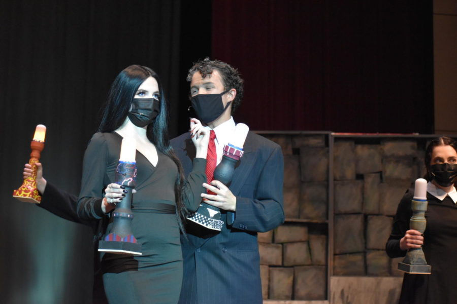 """Junior Nathan Bigler pleads with his scene partner senior Dakota Horrocks in the spring musical The Addams Family. The preparation up until this show required a lot of effort from the cast. """"[The process] was so intense,"""" Bigler said. """"It was a good experience, but it wasn't the normal process of musicals, because this whole year has been not normal."""""""