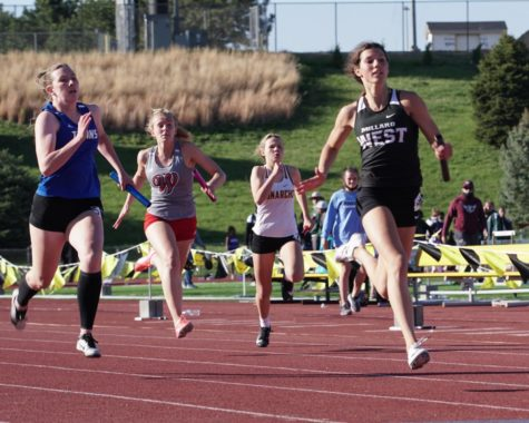 """Junior Sadie Millard running in the 4x100 event. The Wildcats took home first place in this event with a time of 49.16 seconds. """"Honestly winning metros was such a 'team' moment,"""" Millard said. """"We all contributed so much and every point mattered. It was so cool and unbelievable being able to share that victory with my whole team."""""""