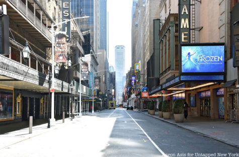New York City's Broadway, usually buzzing with tourists, artists and activity, remains lifeless during the pandemic.