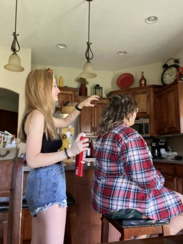 "Senior Milina Mike styles hair for a prom event. ""I grew up with cosmetology surrounding me constantly,"" Mike said. ""My parents have prepared me my whole life. I've learned a lot of technique and I have shadowed multiple students at the school to get an idea of what life will be like while I'm there."""