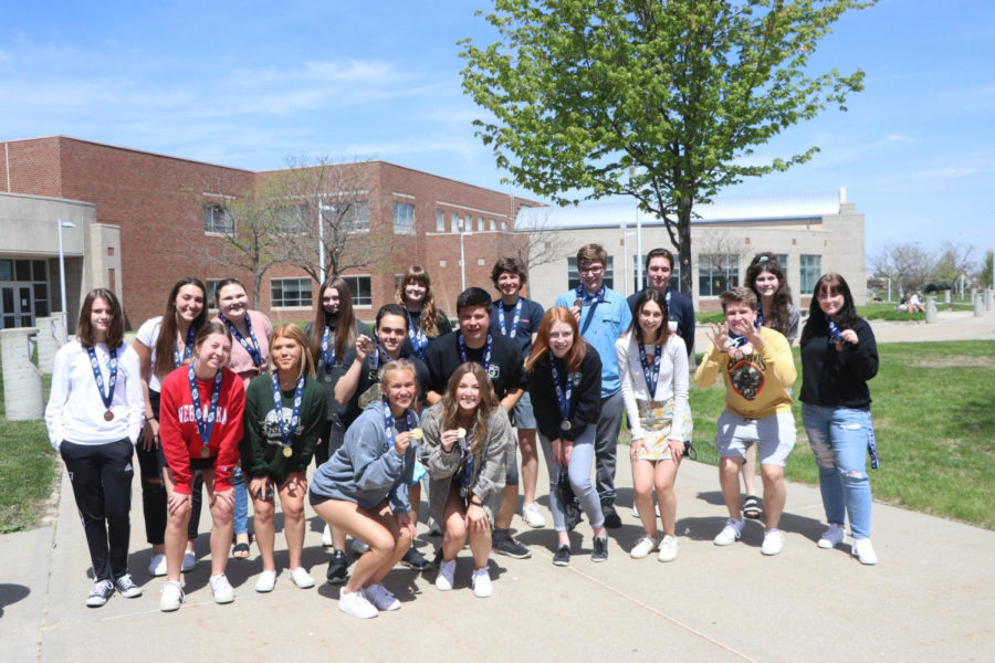 Photo by Mark Hilburn Advanced Journalism and Yearbook staff members show off their medals after a virtual awards ceremony on April 30, 2021.