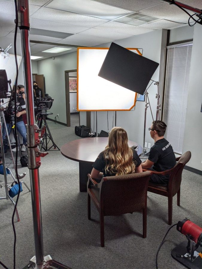 """Millard West alumni Joseph Drwal and Sophie Hill prepare to film Unified Talks, a collaboration between Special Olympics Unified Champion Schools and Nickelodeon. The video will be used in Unified Classroom to teach grades K-12 about how to be an inclusive leader.  """"I hope that the youth who see this recognize that they have the power to spark change and lead within their school or community,"""" Hill said. """"Everyone brings different skills to the table and has the potential to be a great leader. It's their job to step up and advocate for what they believe in."""""""