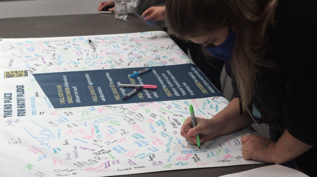 Students sign the Resolution of Respect poster as a way to affirm their belief in the ideas promoted by the ADL and No Place for Hate campaign. The No Place for Hate is a student driven campaign that highlights the importance of making sure schools have an equitable and collaborative climate.